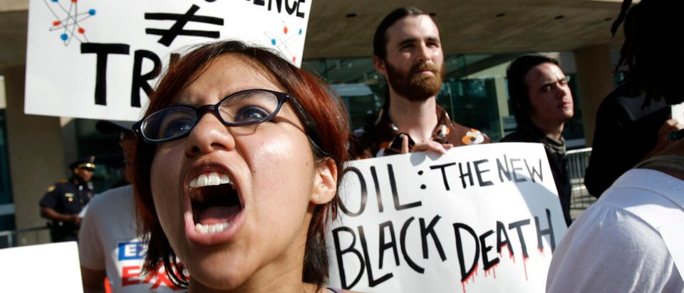 Vanessa Azcona of Denton shouts during a protest outside of the annual shareholders' meeting of ExxonMobil in Dallas