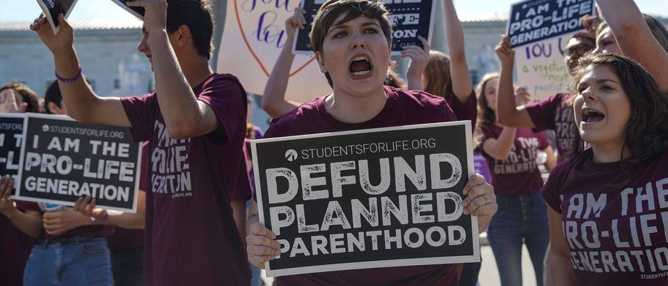 Pro-life and pro-choice protesters rally outside the U.S. Supreme Court waiting for the National Institute of Family and Life Advocates v. Becerra case in Washington