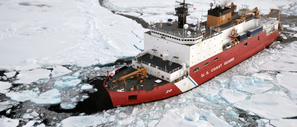 The Coast Guard Cutter Healy breaks ice ahead of the Canadian Coast Guard Ship Louis S. St-Laurent (not seen) during an Arctic expedition in this Aug. 31, 2009 handout photo. REUTERS/U.S. Coast Guard/Patrick Kelley/Handout