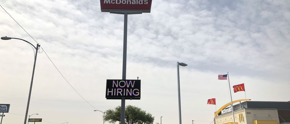 A McDonald's restaurant displays a 'Now Hiring' sign, one of many seen at businesses where an oil boom is fueling worker shortages, in Odessa, Texas, U.S., April 13, 2018. REUTERS/Ann Saphir