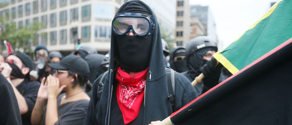 Antifa, opponents of white nationalist Jason Kessler's group, march during a rally in Washington