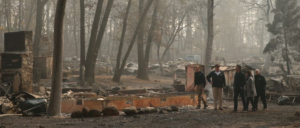 President Donald Trump visits the charred wreckage of Skyway Villa Mobile Home and RV Park with FEMA head Brock Long Governor-elect Gavin Newsom Paradise Mayor Jody Jones and Governor Jerry Brown in Paradise California