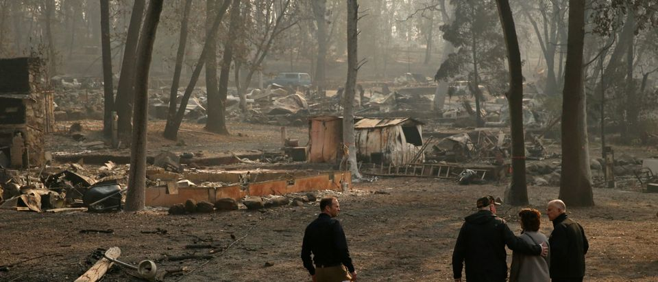 U.S. President Donald Trump visits a neighborhood recently destroyed by the Camp fire in Paradise, California, U.S.