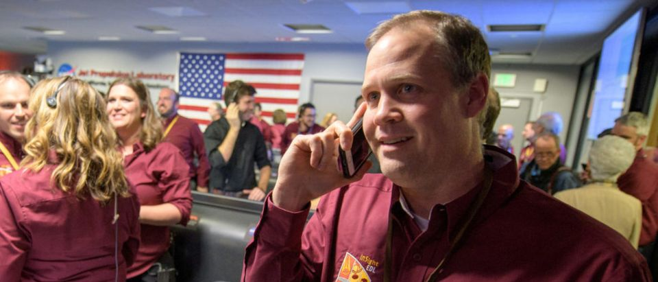 NASA Administrator Bridenstine receives a congratulatory call from U.S. Vice President Pence after the Mars InSight lander successfully touched down on the surface of Mars, in Pasadena