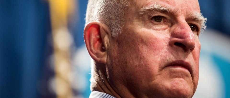 California Gov. Jerry Brown looks on during a news conference at the State Capitol in Sacramento, California in this file photo taken March 19, 2015. Brown on April 4, 2016 was expected to sign into a law a plan to raise the minimum wage from $10 to $15 an hour by the year 2023, making the nation's most-populous state the first to boost pay to that level for the working poor. REUTERS/Max Whittaker/Files