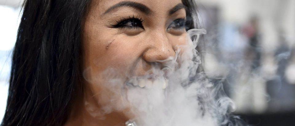 Monique Agra samples flavored vape juices at the Vape Summit 3 in Las Vegas, Nevada May 2, 2015. REUTERS/David Becker