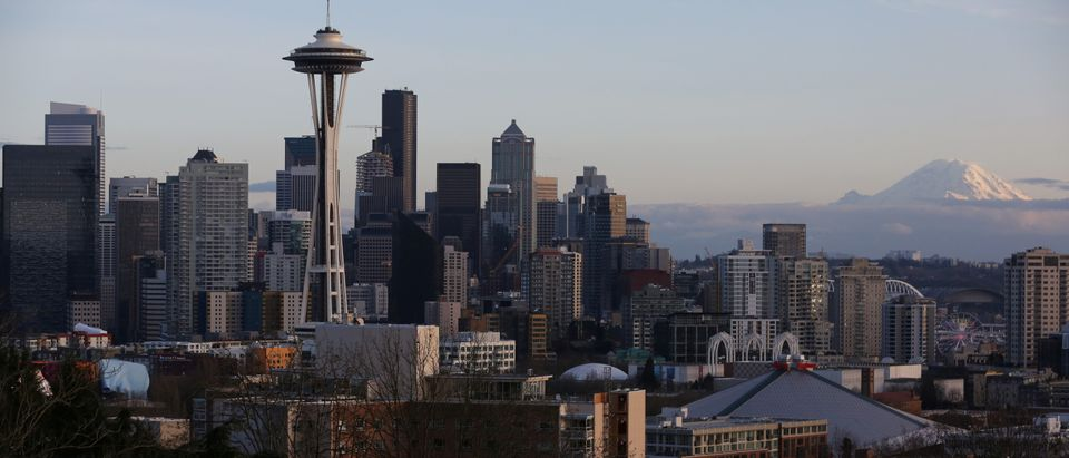 The Space Needle and Mount Rainier are seen on the skyline of Seattle