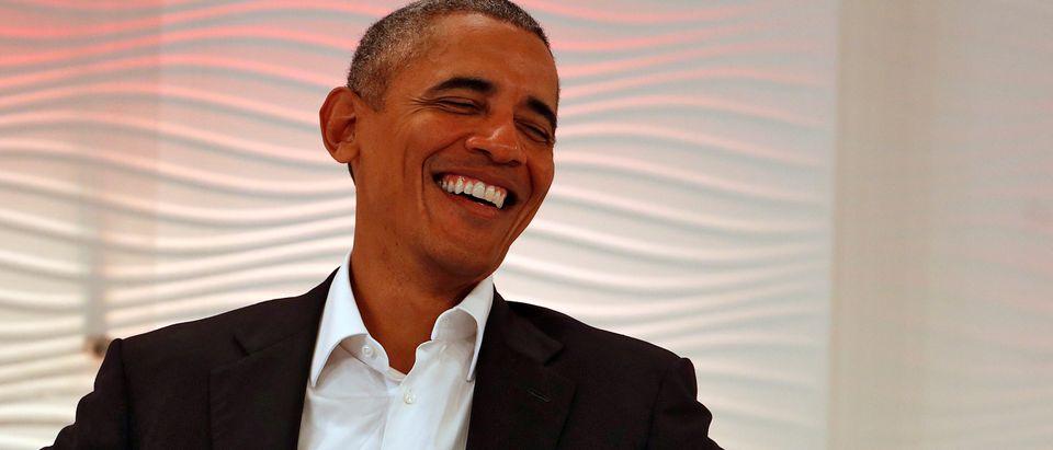 Former U.S. President Barack Obama reacts during a Leadership Summit in Delhi