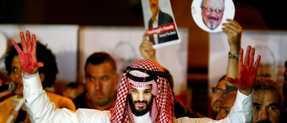 FILE PHOTO: FILE PHOTO: A demonstrator wearing a mask of Saudi Crown Prince Mohammed bin Salman attends a protest outside the Saudi Arabia consulate in Istanbul