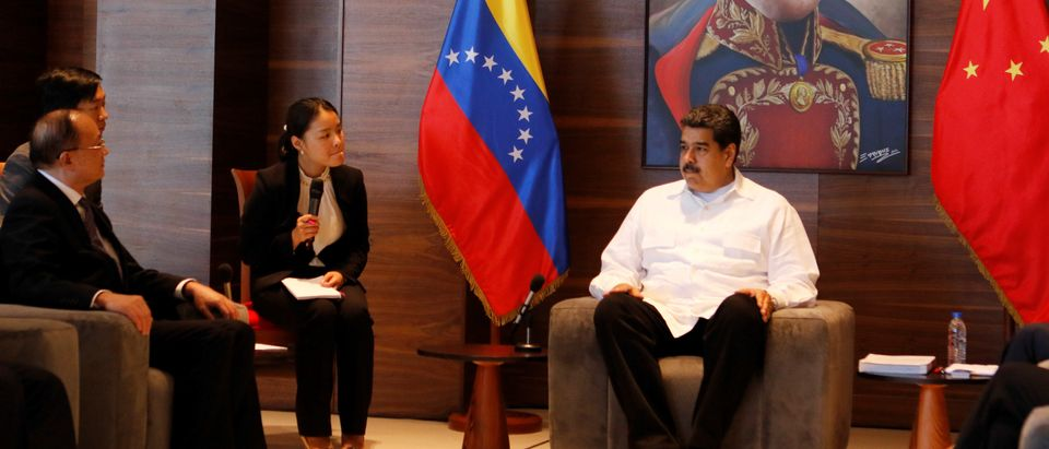 Venezuela's President Nicolas Maduro attends a meeting with advisers from the research center for the development of the State Council of the People's Republic of China in Caracas, Venezuela October 30, 2018. Miraflores Palace/Handout via REUTERS