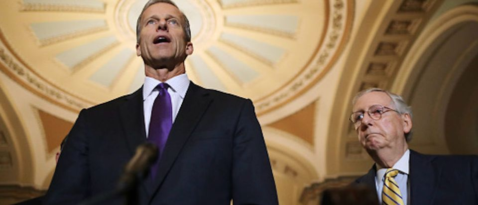 Sen. John Thune (R-SD) talks to reporters with Senate Majority Leader Mitch McConnell (R-KY) following the weekly Senate Republican policy luncheon at the U.S. Capitol October 02, 2018 in Washington, DC