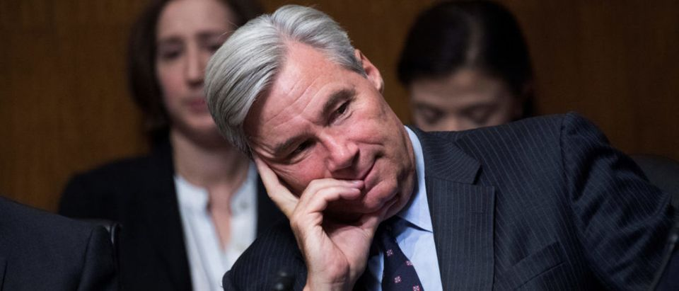 Sen. Sheldon Whitehouse, D-R.I., listens to testimony by Dr. Christine Blasey Ford during the Senate Judiciary Committee hearing on the nomination of Brett M. Kavanaugh to be an associate justice of the Supreme Court of the United States, focusing on allegations of sexual assault by Kavanaugh against Christine Blasey Ford in the early 1980s. Sen. Orrin Hatch, R-Utah, also appears, in Washington, DC, U.S., September 27, 2018. Picture taken September 27, 2018. Tom Williams/Pool via REUTERS