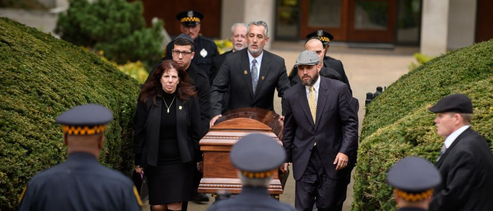 PITTSBURGH, PA - OCTOBER 31: The casket of Irving Younger is led to a hearse outside Rodef Shalom Temple following his funeral on October 31, 2018 in Pittsburgh, Pennsylvania. Irving Younger was one of 11 people killed in the mass shooting at the Tree of Life Synagogue on October 27. (Photo by Jeff Swensen/Getty Images)