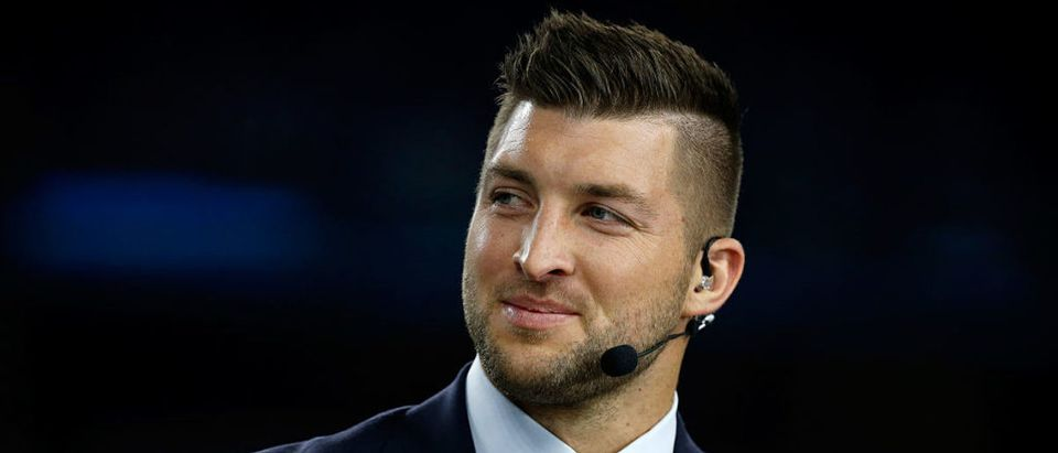 Broadcaster Tim Tebow of the SEC Network speaks on air before the Goodyear Cotton Bowl at AT&T Stadium on December 31, 2015 in Arlington, Texas. (Photo by Scott Halleran/Getty Images)