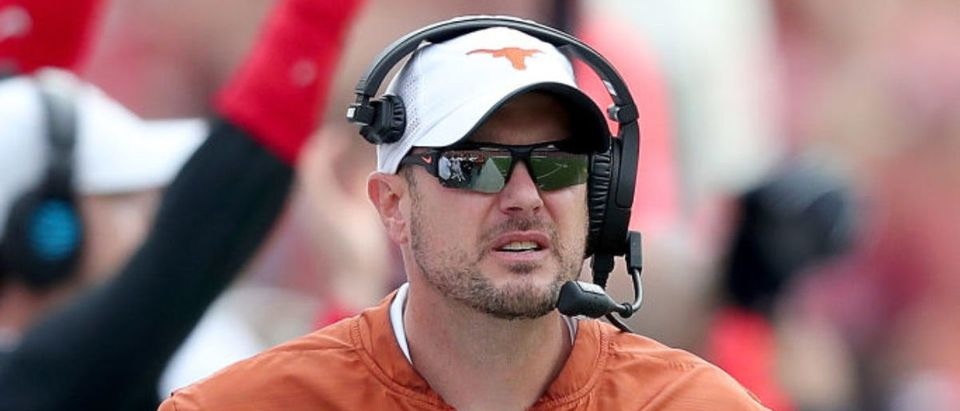 DALLAS, TX - OCTOBER 06: Head coach Tom Herman of the Texas Longhorns leads the Texas Longhorns against the Oklahoma Sooners in the first half of the 2018 AT&T Red River Showdown at Cotton Bowl on October 6, 2018 in Dallas, Texas. (Photo by Tom Pennington/Getty Images)