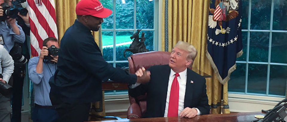 US President Donald Trump meets with rapper Kanye West in the Oval Office of the White House in Washington, DC, October 11, 2018