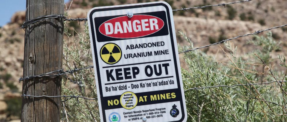 A warning sign is seen next to the entry to the Northeast Church Rock abandoned uranium mine in Pinedale, New Mexico on July 19, 2018. REUTERS/Pamela J. Peters