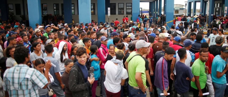 Venezuelan migrants wait to cross border at the Binational Border Service Center of Peru, on the border with Ecuador, in Tumbes