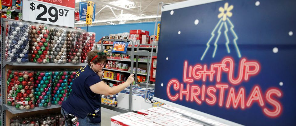 An employee works on a display ahead of Black Friday at a Walmart store in Chicago, Illinois, U.S., Nov. 20, 2018. REUTERS/Kamil Krzaczynski