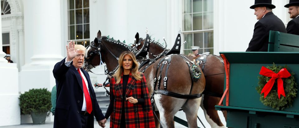 U.S. President Donald Trump and first lady Melania Trump receive the official White House Christmas tree at the North Portico of the White House in Washington, U.S., November 19, 2018. REUTERS/Kevin Lamarque