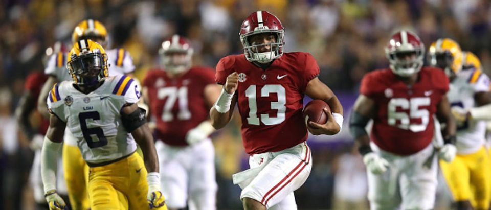 BATON ROUGE, LA - NOVEMBER 03: Tua Tagovailoa #13 of the Alabama Crimson Tide runs for a third quarter touchdown while playing the LSU Tigers at Tiger Stadium on November 3, 2018 in Baton Rouge, Louisiana. Alabama won the game 29-0.