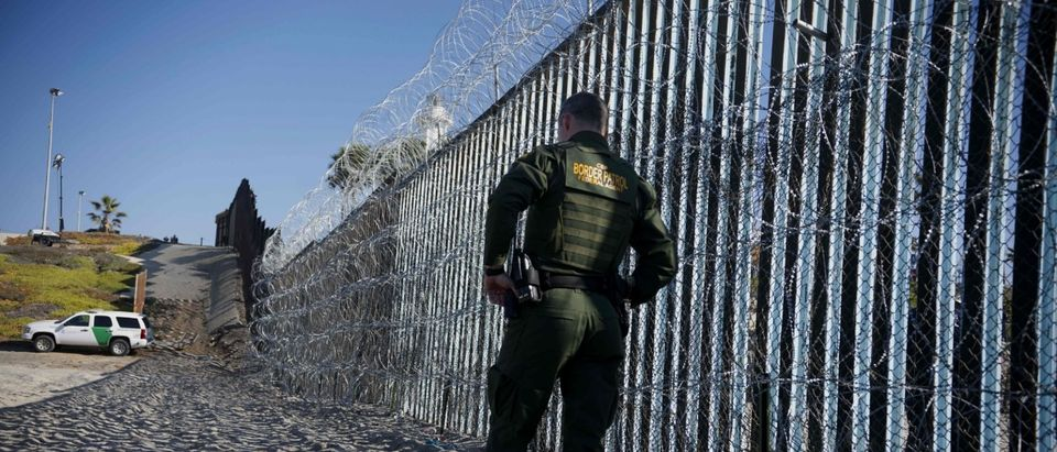 A Border patrol officer walks along the US-Mexico border fence at Borderfield State Park in San Ysidro, California on November 20, 2018. - A US federal judge temporarily blocked Donald Trump's administration from denying asylum to people who enter the country illegally, prompting the president to allege Tuesday that the court was biased against him. (Photo by Sandy Huffaker / AFP) ( SANDY HUFFAKER/AFP/Getty Images)