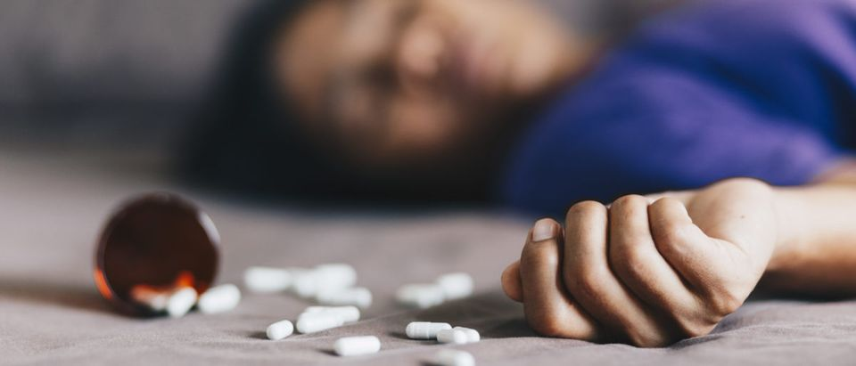 An individual overdoses on drugs. Shutterstock image via user Anut21ng Photo