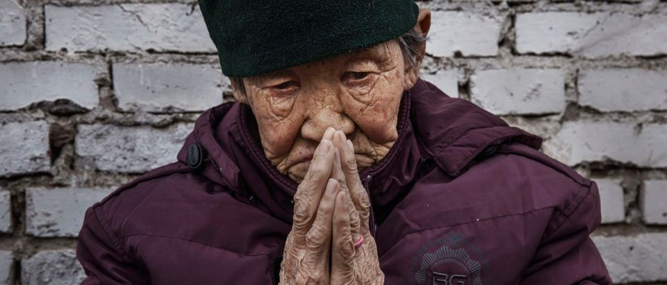 "Chinese Christians Mark Holy Week At Underground Church. A Chinese Catholic worshipper prays at a Palm Sunday Mass during the Easter Holy Week at an ""underground"" or ""unofficial"" church on April 9, 2017 near Shijiazhuang, Hebei Province, China. China, an officially atheist country, places a number of restrictions on Christians, allowing legal practice of the faith only at state-approved churches. The policy has driven an increasing number of Christians and Christian converts 'underground' to secret congregations in private homes and other venues. (Photo by Kevin Frayer/Getty Images)"