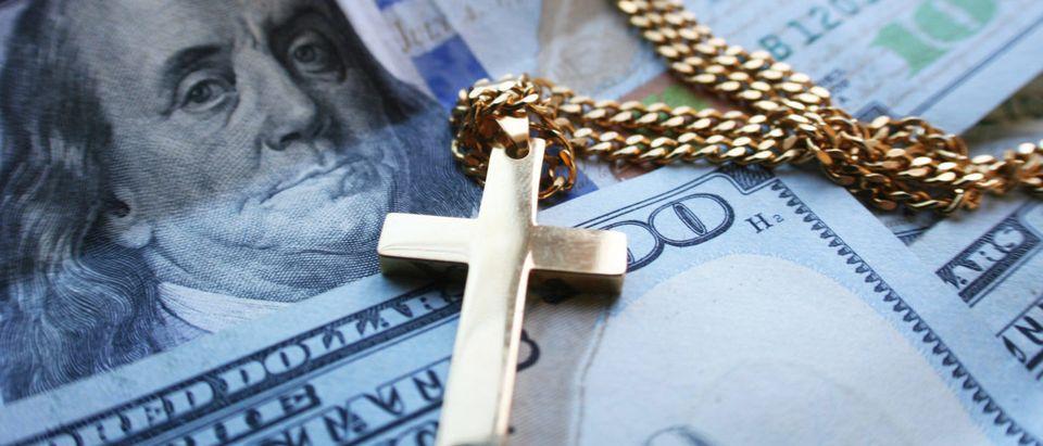 Church Money (Shutterstock/ShutterstockProfessional)
