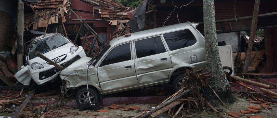 Damaged cars are seen among collapsed houses after a tsunami hit Banten, Indonesia, Dec. 23, 2018. Antara Foto/Dian Triyuli Handoko/ via REUTERS
