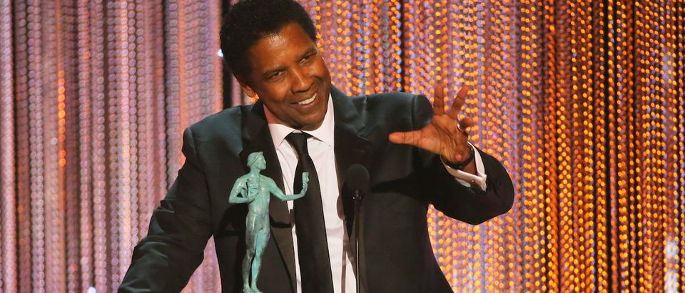 Denzel Washington accepts his award for Male Actor in a Leading Role during the 23rd Screen Actors Guild Awards in Los Angeles, California, U.S., January 29, 2017. REUTERS/Mike Blake