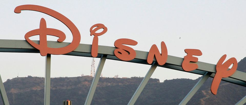 "A part of the signage at the main gate of The Walt Disney Co. is pictured in Burbank, California, May 7, 2012. Walt Disney Co's quarterly earnings beat Wall Street expectations as profit rose 21 percent despite a loss from the science fiction film bomb ""John Carter."" The signage for the ABC television network, which is owned by Disney, is shown background. Picture taken May 7, 2012. REUTERS/Fred Prouser"