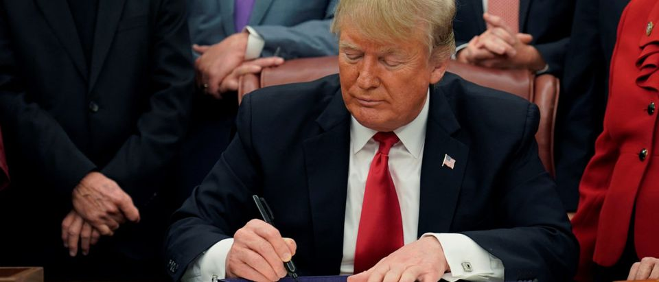 U.S. President Trump signs criminal justice reform bills during bill signing ceremony in the Oval Office of the White House in Washington