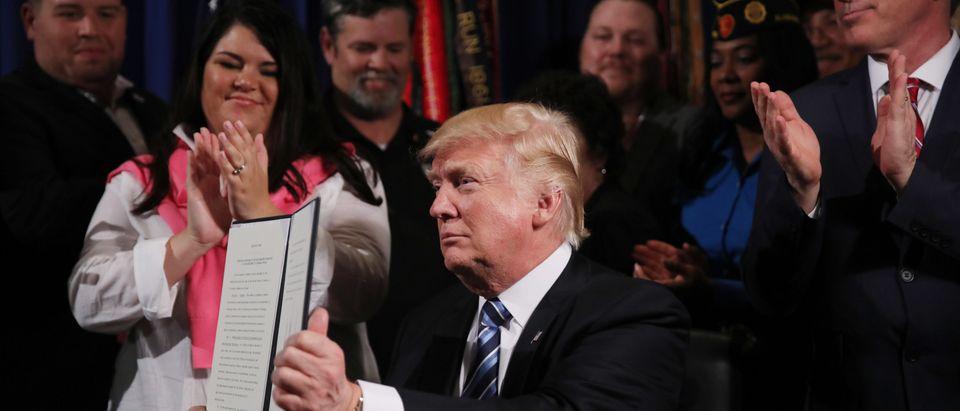 U.S. President Trump displays VA Executive Order at the Veterans Affairs Department in Washington