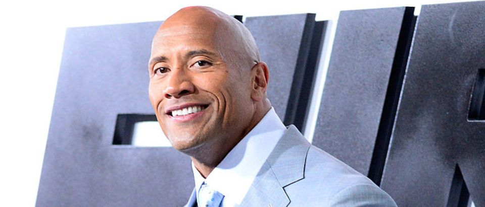 Actor Dwayne Johnson arrives at Universal Pictures Premiere of 'Furious 7'' at the TLC Chinese Theatre, Hollywood, on April 1, 2015 in Los Angeles.CA (Photo by Frazer Harrison/Getty Images)