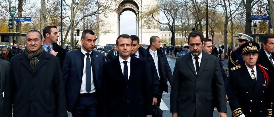 French President Emmanuel Macron (center) on a visit to the riot-battered neighborhood around the Arc de Triomphe in Paris, Dec. 2, 2018. Thibault Camus/Pool via REUTERS