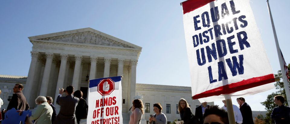 Demonstrators rally during oral arguments in Gill v. Whitford, a case about partisan gerrymandering in electoral districts, at the Supreme Court in Washington. REUTERS/Joshua Roberts