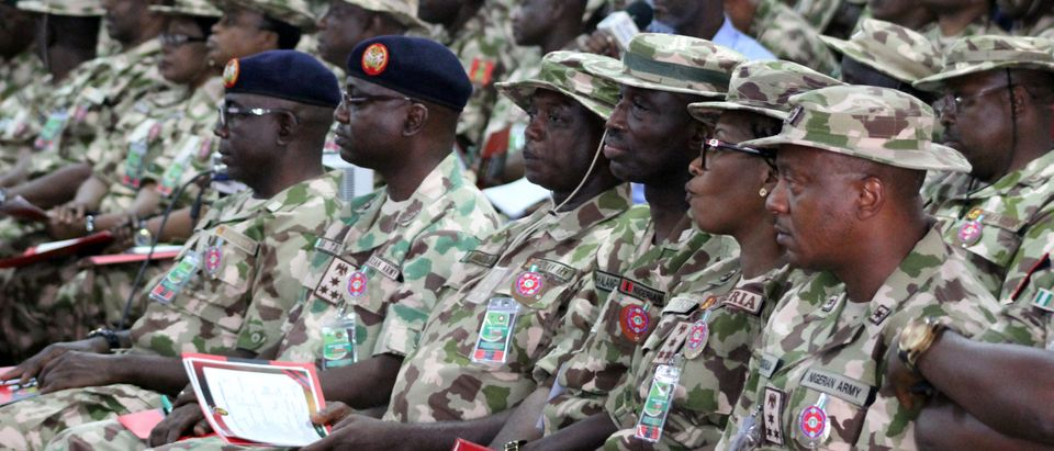 Nigerian army officers listen to a speech of Nigerian president during the opening ceremony of the military staff annual conference, on November 28, 2018, as part of his trip to visit troops on front lines of Boko Haram conflict. AUDU MARTE/AFP/Getty Images)