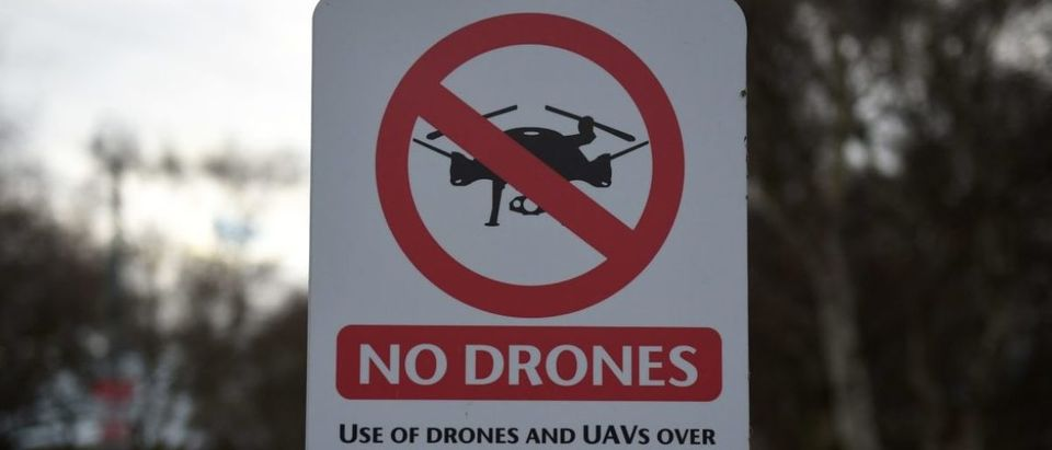 "A ""No Drones"" sign alerting members of the public that the use of drones or unmanned aerial vehicles (UAV) is prohibited, is pictured outside Manchester United's Carrington Training complex in Manchester, north west England on December 20, 2018. - London Gatwick Airport was forced to suspend all flights Thursday due to drones flying over the airfield, causing misery for tens of thousands of stuck passengers just days before Christmas. (Photo by Oli SCARFF / AFP)"