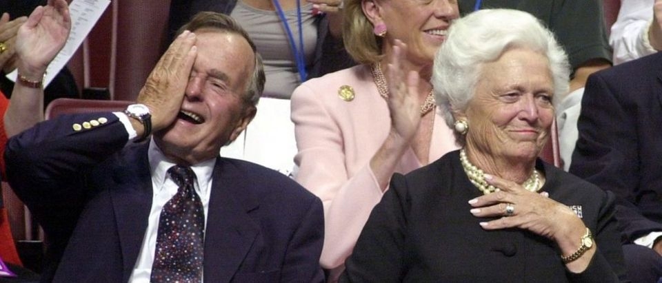Former US President George Bush (L) and his wife Barbara laugh during the evening session of the 2000 Republican National Convention in Philadelphia's First Union Center 31 July, 2000. The Bush family is on hand this week to see their son receive the nomination of the Republican Party for the 2000 presidential election. (ELECTRONIC IMAGE) AFP PHOTO/Roberto SCHMIDT