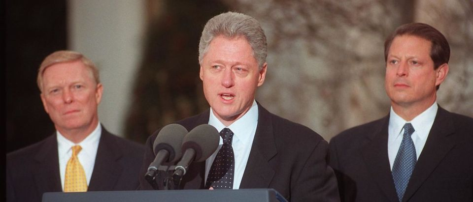 US President Bill Clinton (C) addresses the nation 19 December from the White House after the US House of Representatives impeached him on charges of perjury and obstruction of justice. (Photo credit should read GEORGE BRIDGES/AFP/Getty Images)