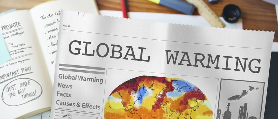"Newspaper headlined ""Global Warming."" (Rawpixel.com/Shutterstock)"