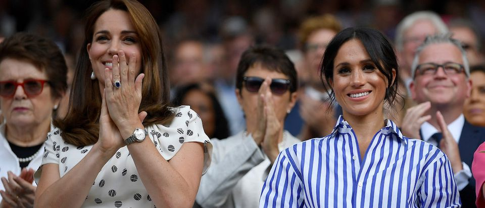 Tennis - Wimbledon - All England Lawn Tennis and Croquet Club, London, Britain - July 14, 2018. Britain's Catherine the Duchess of Cambridge and Meghan the Duchess of Sussex applaud after Germany's Angelique Kerber won the women's singles final against Serena Williams of the U.S. REUTERS/Toby Melville