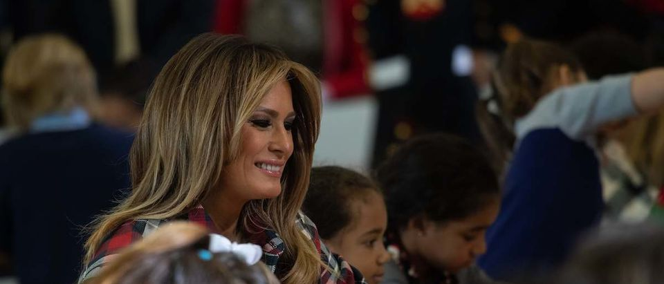 US First Lady Melania Trump gives attends a a Toys for Tots event at Joint Base Anacostia-Bolling in Washington, DC, on December 11, 2018. - Toys for Tots is a program run by the United States Marine Corps Reserve which distributes toys to children whose parents cannot afford to buy them gifts for Christmas. (Photo credit: NICHOLAS KAMM/AFP/Getty Images