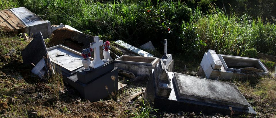 Graves destroyed during Hurricane Maria in September 2017, are seen at a cemetery, in Lares, Puerto Rico, February 8, 2018. Picture taken February 8, 2018. REUTERS/Alvin Baez