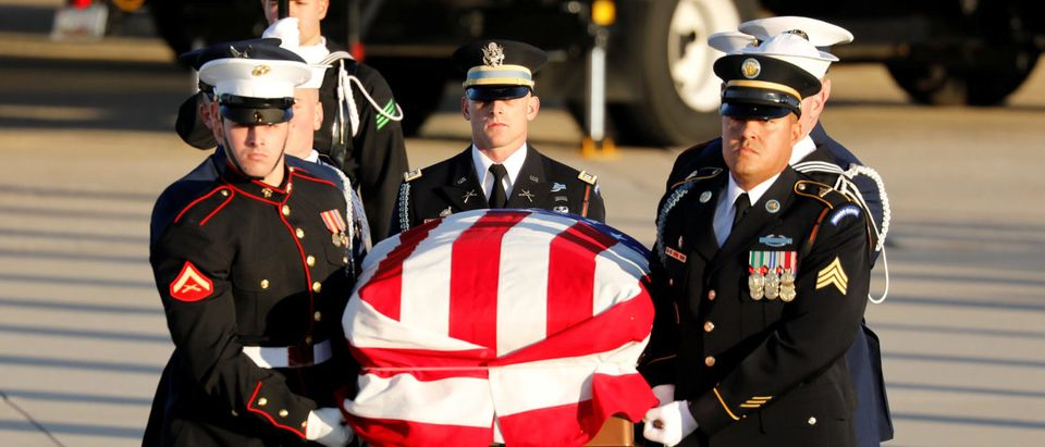 The casket of former U.S. President George H.W. Bush arrives at Joint Base Andrews in Maryland