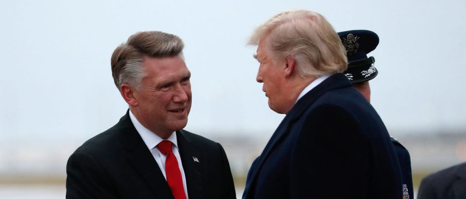 U.S. President Donald Trump greets Mark Harris, Republican candidate from North Carolina's 9th Congressional district, in Charlotte, North Carolina, U.S., Oct. 26, 2018. REUTERS/Kevin Lamarque