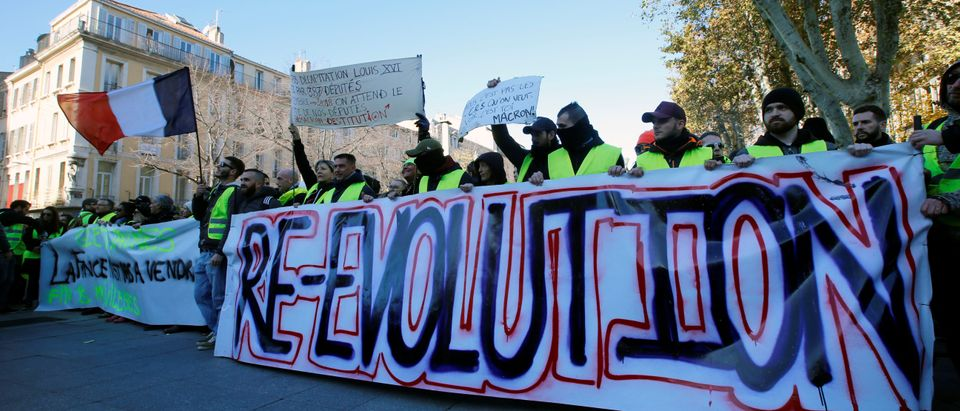 "Protesters wearing yellow vests take part in a demonstration of the ""yellow vests"" movement in Marseille"