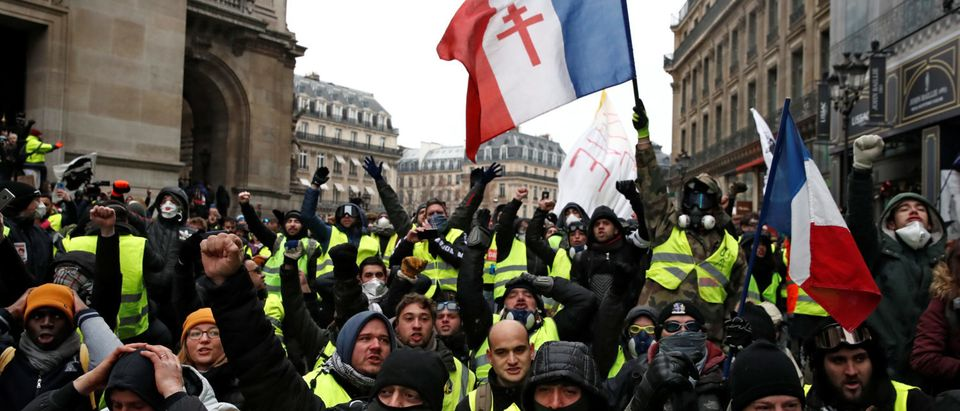 """Protesters wearing yellow vests gather near the Opera House as part of the """"yellow vests"""" movement in Paris, France, December 15, 2018. REUTERS/Christian Hartmann."""