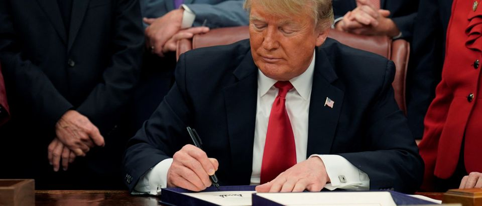 U.S. President Donald Trump signs the First Step Act and the Juvenile Justice Reform Act in the Oval Office of the White House in Washington, U.S., Dec. 21, 2018. REUTERS/Joshua Roberts